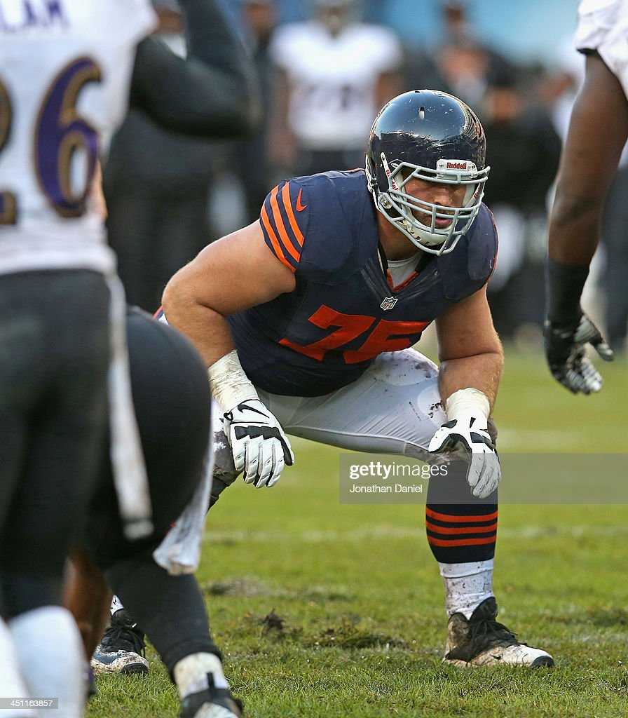 Kyle Long #75 of the Chicago Bears awaits the snaps against the Baltimore Ravens at Soldier Field on November 17, 2013 in Chicago, Illinois. The Bears defeated the Ravens 23-20 in overtime.