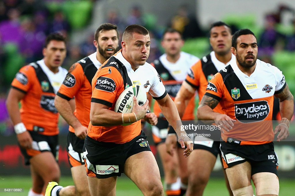 Kyle Lovett of the Tigers runs during the round 16 NRL match between the Melbourne Storm and Wests Tigers at AAMI Park on June 26, 2016 in Melbourne, Australia.