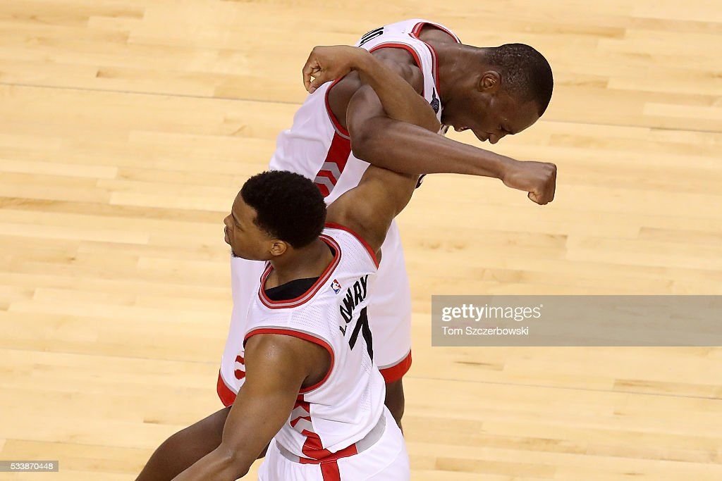Kyle Lowry #7 and Bismack Biyombo #8 of the Toronto Raptors celebrate late in the game against the Cleveland Cavaliers in game four of the Eastern Conference Finals during the 2016 NBA Playoffs at the Air Canada Centre on May 23, 2016 in Toronto, Ontario, Canada.