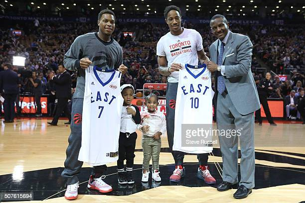 Kyle Lowry and DeMar DeRozan get their allstar jerseys from Dwane Casey before the game as the Toronto Raptors play the Detroit Pistons at the Air...