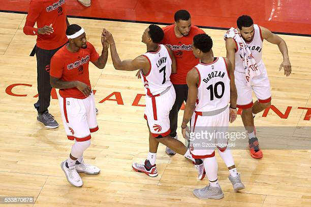 Kyle Lowry and DeMar DeRozan of the Toronto Raptors celebrate with teammates late in the game against the Cleveland Cavaliers in game four of the...