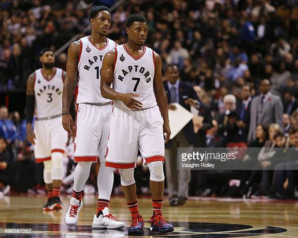 Kyle Lowry and DeMar DeRozan of the Toronto Raptors during an NBA game against the New York Knicks at the Air Canada Centre on November 10 2015 in...