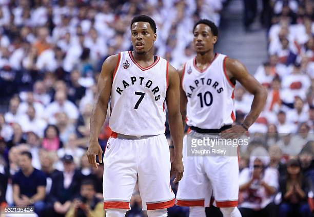 Kyle Lowry and DeMar DeRozan of the Toronto Raptors look on in the first half of Game Seven of the Eastern Conference Quarterfinals against the Miami...