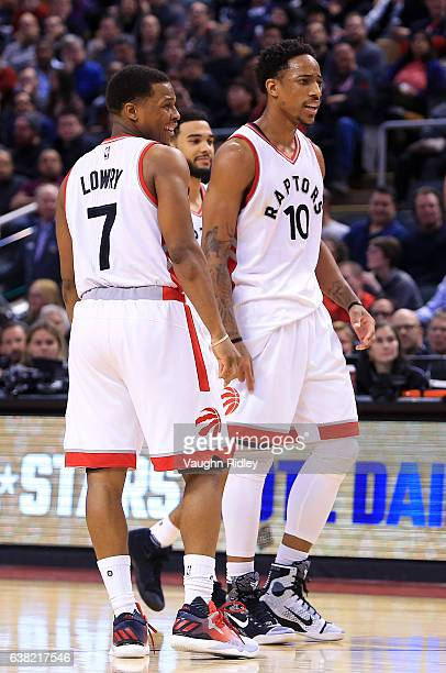Kyle Lowry and DeMar DeRozan of the Toronto Raptors reacts to a call by an official during the second half of an NBA game against the Houston Rockets...