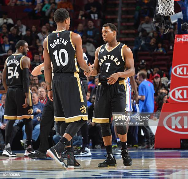 Kyle Lowry and DeMar DeRozan of the Toronto Raptors share a moment against the Philadelphia 76ers at Wells Fargo Center on January 9 2015 in...
