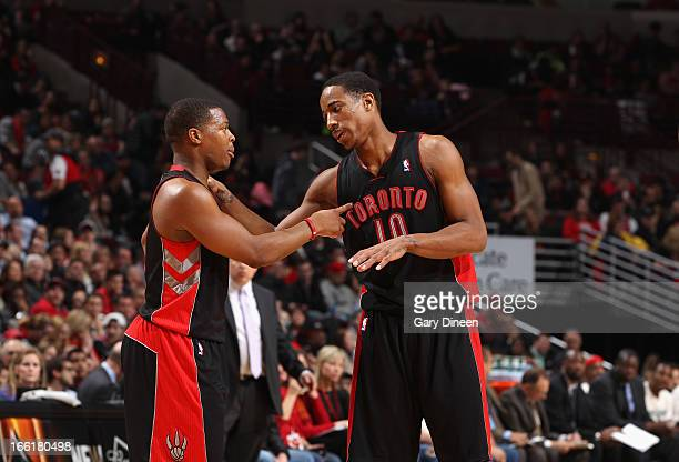Kyle Lowry and DeMar DeRozan of the Toronto Raptors share a word during the game against the Chicago Bulls on April 09 2013 at the United Center in...