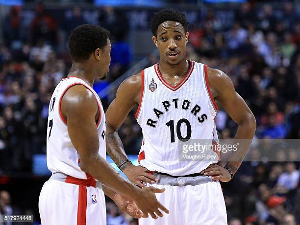 Kyle Lowry and DeMar DeRozan of the Toronto Raptors talk during the first half of an NBA game against the Oklahoma City Thunder at the Air Canada...