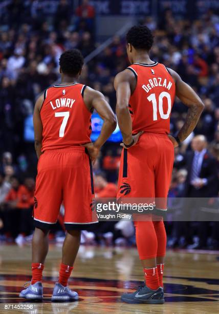 Kyle Lowry and DeMar DeRozan of the Toronto Raptors talk during the first half of an NBA game against the Chicago Bulls at Air Canada Centre on...