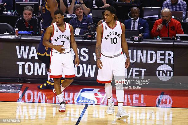 Kyle Lowry and DeMar DeRozan of the Toronto Raptors walk on the court during Game Six of the NBA Eastern Conference Finals against the Cleveland...