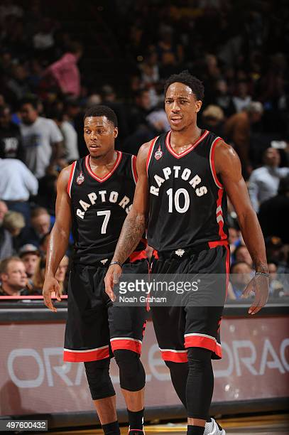 Kyle Lowry and DeMar DeRozan of the Toronto Raptors while facing the Golden State Warriors on November 17 2015 at Oracle Arena in Oakland California...