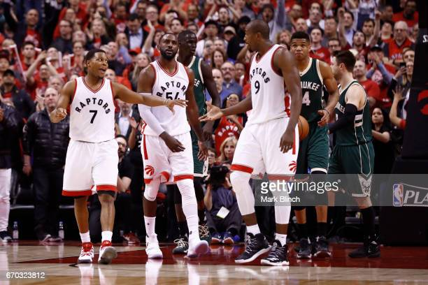 Kyle Lowry and Serge Ibaka of the Toronto Raptors high five and talk during Game Two of the Eastern Conference Quarterfinals against the Milwaukee...