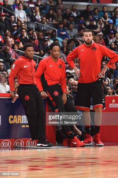 Kyle Lowry DeMar DeRozan and Jonas Valanciunas of the Toronto Raptors react to a play against the LA Clippers on December 11 2017 at STAPLES Center...