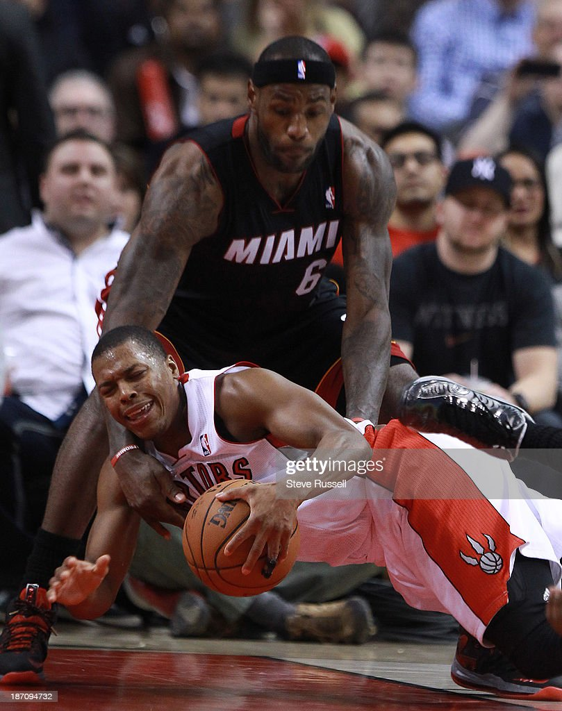 TORONTO, ON- NOVEMBER 5 - Kyle Lowry falls in front of LeBron James as the Toronto Raptors lose to the Miami Heat at Air Canada Centre in Toronto. November 5, 2013.