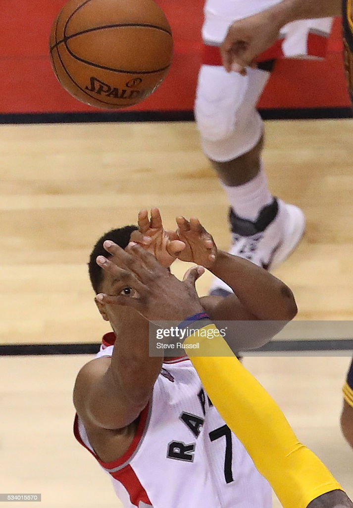 Kyle Lowry keeps his eye on his shot as LeBron James defends as the Toronto Raptors beat the Cleveland Cavaliers in game 4 of the NBA Conference Finals in Toronto. May 23, 2016.
