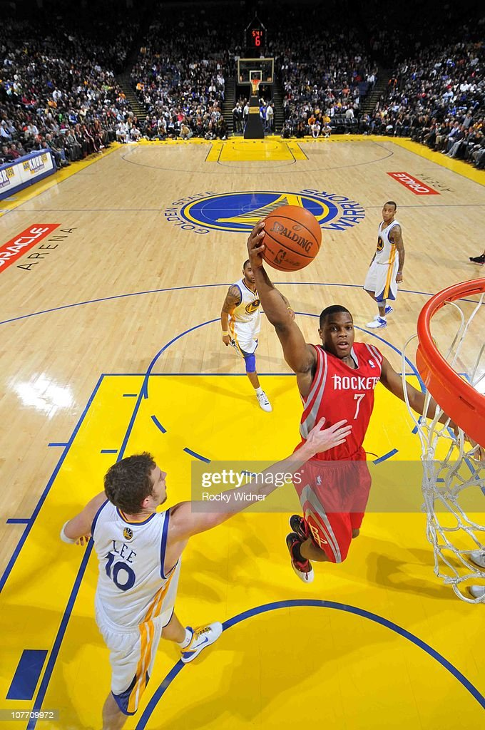 Kyle Lowry #7 of the Houston Rockets attempts to dunk the ball over David Lee #10 of the Golden State Warriors on December 20, 2010 at Oracle Arena in Oakland, California.