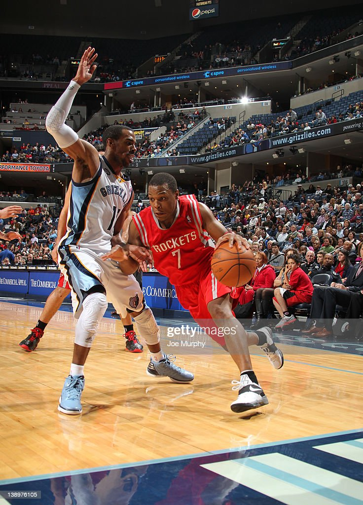 <a gi-track='captionPersonalityLinkClicked' href=/galleries/search?phrase=Kyle+Lowry&family=editorial&specificpeople=714625 ng-click='$event.stopPropagation()'>Kyle Lowry</a> #7 of the Houston Rockets drives around Mike Conley #11 of the Memphis Grizzlies on February 14, 2012 at FedExForum in Memphis, Tennessee.