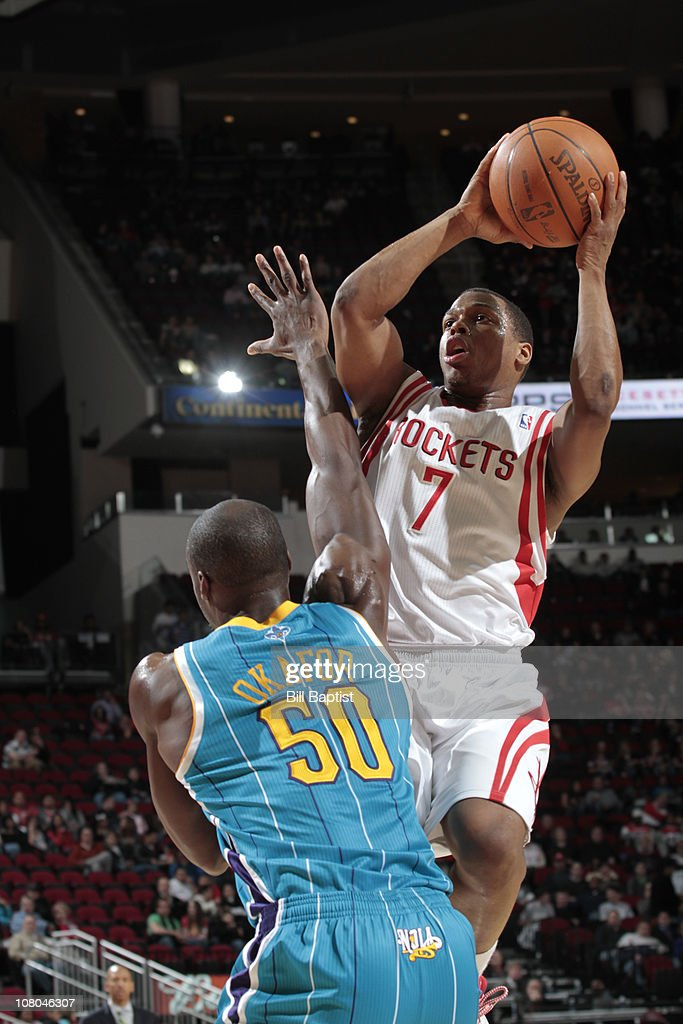 Kyle Lowry of the Houston Rockets shoots the ball over Emeka Okafor of the New Orleans Hornets during a game on January 14 2011 at the Toyota Center...