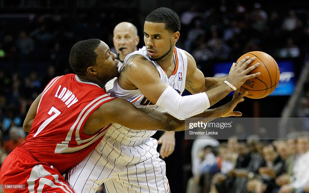 <a gi-track='captionPersonalityLinkClicked' href=/galleries/search?phrase=Kyle+Lowry&family=editorial&specificpeople=714625 ng-click='$event.stopPropagation()'>Kyle Lowry</a> #7 of the Houston Rockets tries to steal the ball away from <a gi-track='captionPersonalityLinkClicked' href=/galleries/search?phrase=D.J.+Augustin&family=editorial&specificpeople=3847521 ng-click='$event.stopPropagation()'>D.J. Augustin</a> #14 of the Charlotte Bobcats during their game at Time Warner Cable Arena on January 10, 2012 in Charlotte, North Carolina.