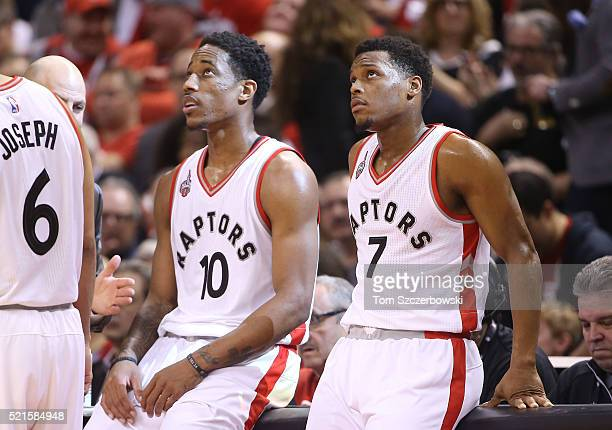 Kyle Lowry of the Toronto Raptors and DeMar DeRozan look on against the Indiana Pacers in Game One of the Eastern Conference Quarterfinals during the...