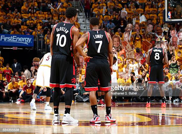Kyle Lowry of the Toronto Raptors and DeMar DeRozan of the Toronto Raptors talk during the game against the Cleveland Cavaliers in Game Five of the...