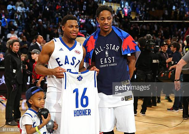 Kyle Lowry of the Toronto Raptors and the Eastern Conference and DeMar DeRozan of the Toronto Raptors and the Eastern Conference hold a jersey after...