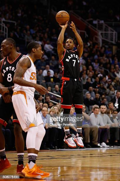 Kyle Lowry of the Toronto Raptors attempts a shot against the Phoenix Suns during the first half of the NBA game at Talking Stick Resort Arena on...