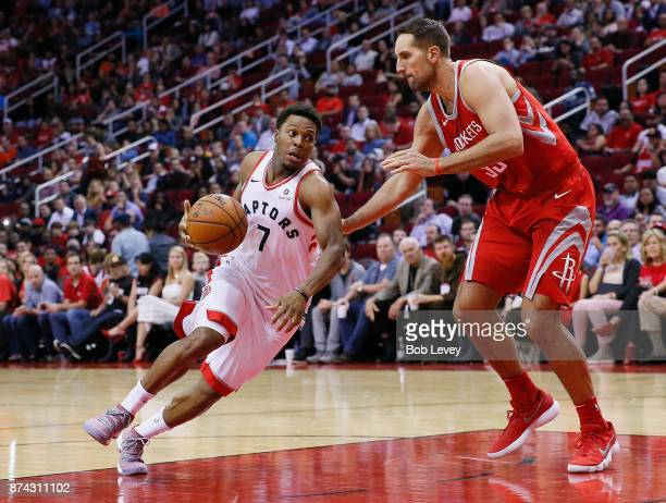 Kyle Lowry of the Toronto Raptors attempts to drive around Ryan Anderson of the Houston Rockets during the fourth quarter at Toyota Center on...