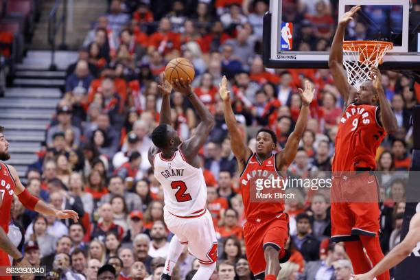 Kyle Lowry of the Toronto Raptors blocks the shot against the Chicago Bulls during the game on October 19 2017 at the Air Canada Centre in Toronto...