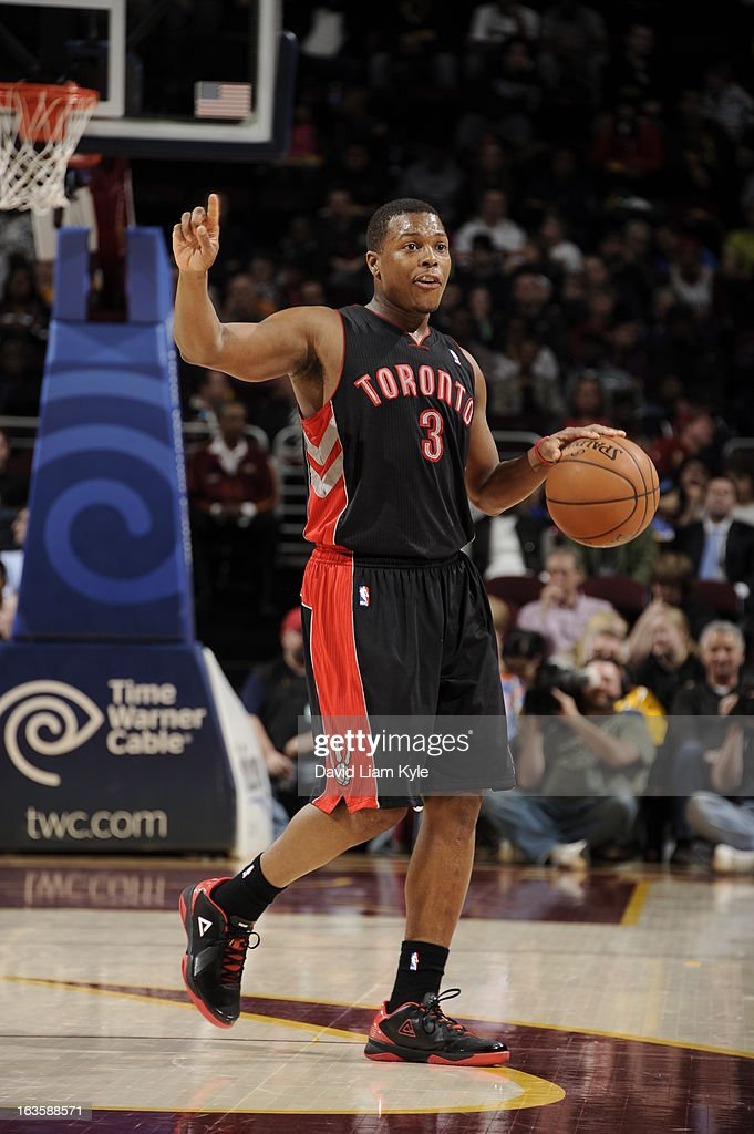 <a gi-track='captionPersonalityLinkClicked' href=/galleries/search?phrase=Kyle+Lowry&family=editorial&specificpeople=714625 ng-click='$event.stopPropagation()'>Kyle Lowry</a> #3 of the Toronto Raptors calls a play against the Cleveland Cavaliers at The Quicken Loans Arena on February 27, 2013 in Cleveland, Ohio.