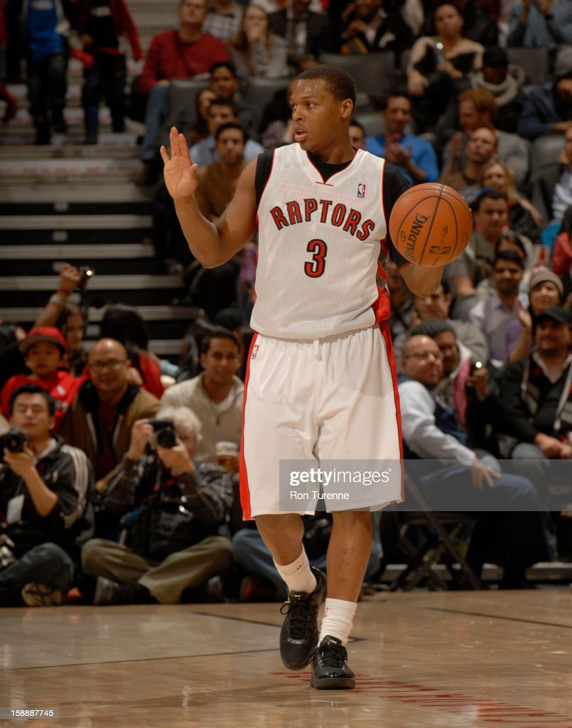 <a gi-track='captionPersonalityLinkClicked' href=/galleries/search?phrase=Kyle+Lowry&family=editorial&specificpeople=714625 ng-click='$event.stopPropagation()'>Kyle Lowry</a> #3 of the Toronto Raptors calls a play against the Portland Trail Blazers during the game on January 2, 2013 at the Air Canada Centre in Toronto, Ontario, Canada.