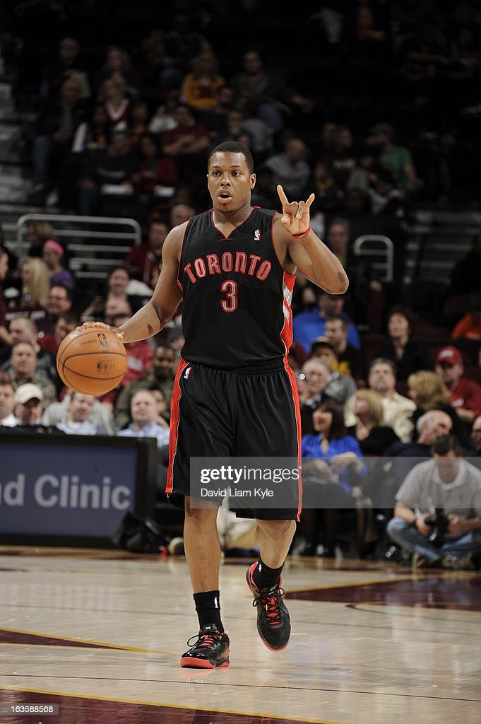 <a gi-track='captionPersonalityLinkClicked' href=/galleries/search?phrase=Kyle+Lowry&family=editorial&specificpeople=714625 ng-click='$event.stopPropagation()'>Kyle Lowry</a> #3 of the Toronto Raptors calls a play during the game against the Cleveland Cavaliers at The Quicken Loans Arena on February 27, 2013 in Cleveland, Ohio.