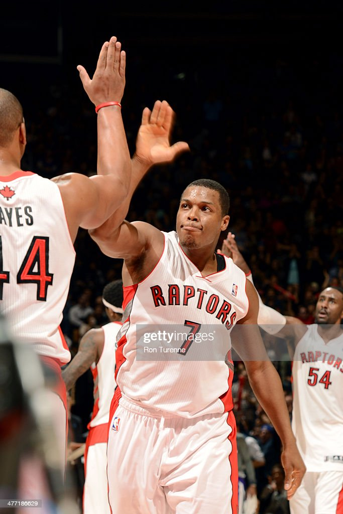 <a gi-track='captionPersonalityLinkClicked' href=/galleries/search?phrase=Kyle+Lowry&family=editorial&specificpeople=714625 ng-click='$event.stopPropagation()'>Kyle Lowry</a> #7 of the Toronto Raptors celebrates during the game against the Sacramento Kings on March 7, 2014 at the Air Canada Centre in Toronto, Ontario, Canada.