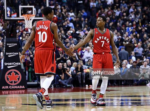 Kyle Lowry of the Toronto Raptors celebrates with teammate DeMar DeRozan late in the second half of an NBA game against the Minnesota Timberwolves at...