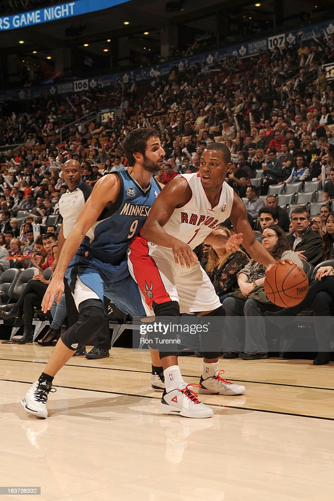 Kyle Lowry #7 of the Toronto Raptors controls the ball against Ricky Rubio #9 of the Minnesota Timberwolves during the game on October 9, 2013 at the Air Canada Centre in Toronto, Ontario, Canada.