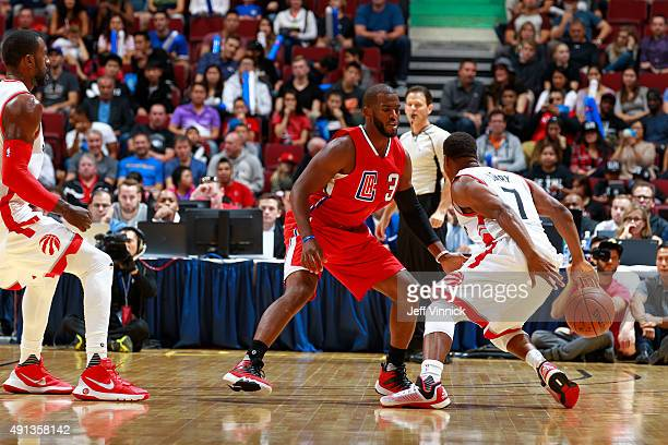 Kyle Lowry of the Toronto Raptors dribbles in front of Chris Paul of the Los Angeles Clippers during their NBA preseason game on October 4 2015 at...