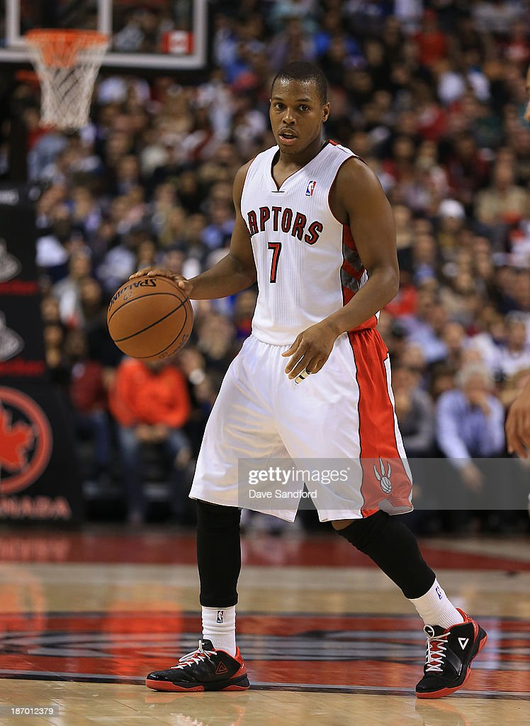 Kyle Lowry #7 of the Toronto Raptors dribbles the ball against the Boston Celtics during their NBA game at the Air Canada Centre on October 30, 2013 in Toronto, Ontario, Canada.
