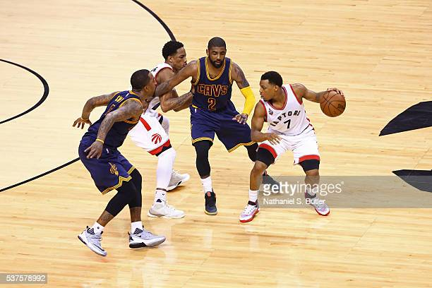 Kyle Lowry of the Toronto Raptors dribbles the ball against the Cleveland Cavaliers during Game Six of the NBA Eastern Conference Finals at Air...