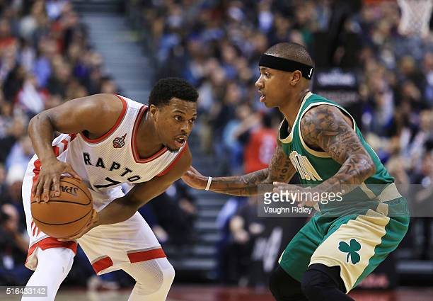 Kyle Lowry of the Toronto Raptors dribbles the ball as Isaiah Thomas of the Boston Celtics defends during the second half of an NBA game at the Air...
