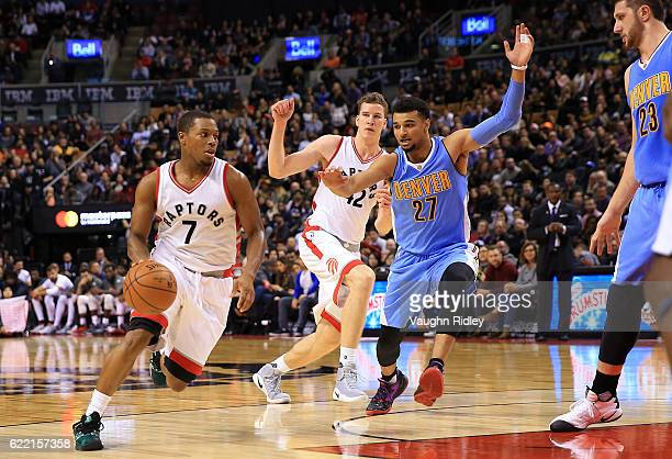 Kyle Lowry of the Toronto Raptors dribbles the ball as Jamal Murray of the Denver Nuggets defends during the second half of an NBA game at Air Canada...