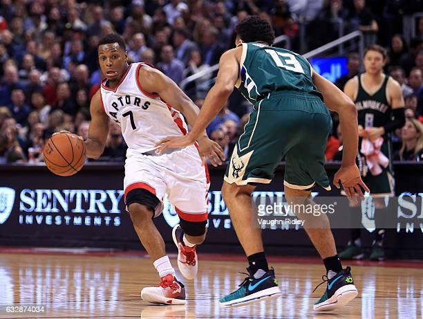 Kyle Lowry of the Toronto Raptors dribbles the ball as Malcolm Brogdon of the Milwaukee Bucks defends during the second half of an NBA game at Air...