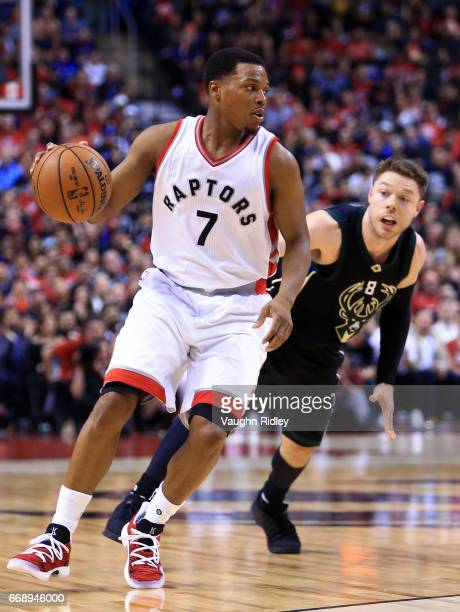 Kyle Lowry of the Toronto Raptors dribbles the ball as Matthew Dellavedova of the Milwaukee Bucks defends in the second half of Game One of the...