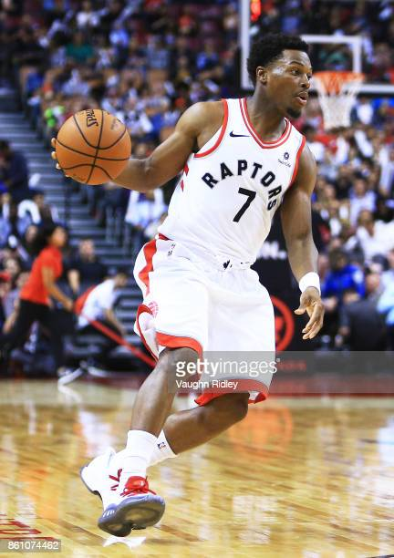 Kyle Lowry of the Toronto Raptors dribbles the ball during the second half of an NBA preseason game against the Detroit Pistons at Air Canada Centre...