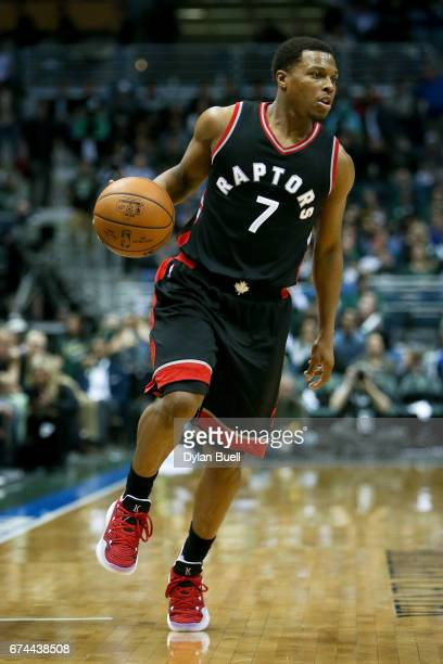 Kyle Lowry of the Toronto Raptors dribbles the ball in the third quarter in Game Six of the Eastern Conference Quarterfinals against the Milwaukee...