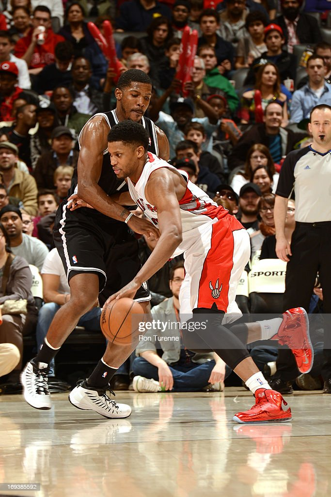<a gi-track='captionPersonalityLinkClicked' href=/galleries/search?phrase=Kyle+Lowry&family=editorial&specificpeople=714625 ng-click='$event.stopPropagation()'>Kyle Lowry</a> #3 of the Toronto Raptors dribbles the ball to the rim against the Brooklyn Nets during the game on April 14, 2013 at the Air Canada Centre in Toronto, Ontario, Canada.