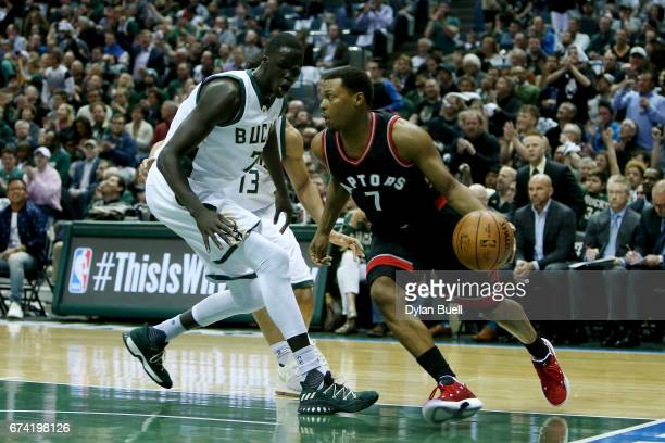 Kyle Lowry of the Toronto Raptors dribbles the ball while being guarded by Thon Maker of the Milwaukee Bucks in the first quarter in Game Six of the...