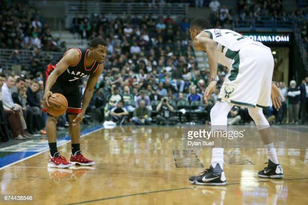 Kyle Lowry of the Toronto Raptors dribbles the ball while being guarded by Giannis Antetokounmpo of the Milwaukee Bucks in the third quarter in Game...