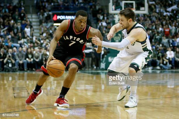 Kyle Lowry of the Toronto Raptors dribbles the ball while being guarded by Matthew Dellavedova of the Milwaukee Bucks in the fourth quarter in Game...