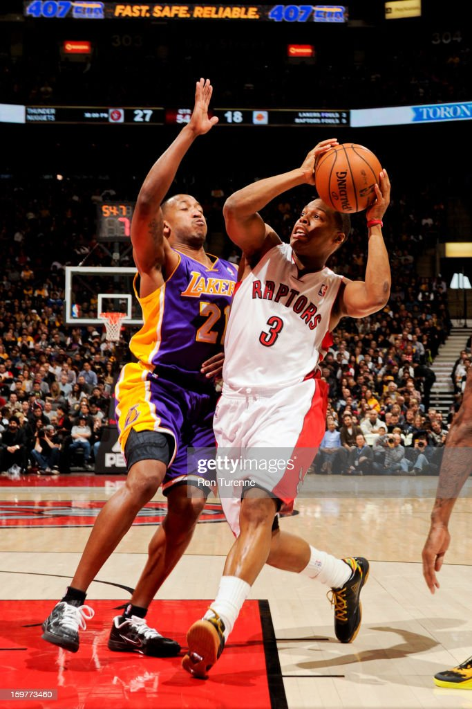 Kyle Lowry #3 of the Toronto Raptors drives against Chris Duhon #21 of the Los Angeles Lakers on January 20, 2013 at the Air Canada Centre in Toronto, Ontario, Canada.