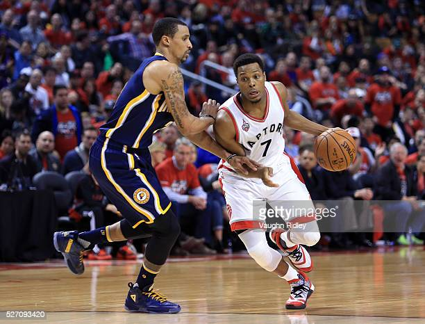 Kyle Lowry of the Toronto Raptors drives against George Hill of the Indiana Pacers in the second half of Game Seven of the Eastern Conference...