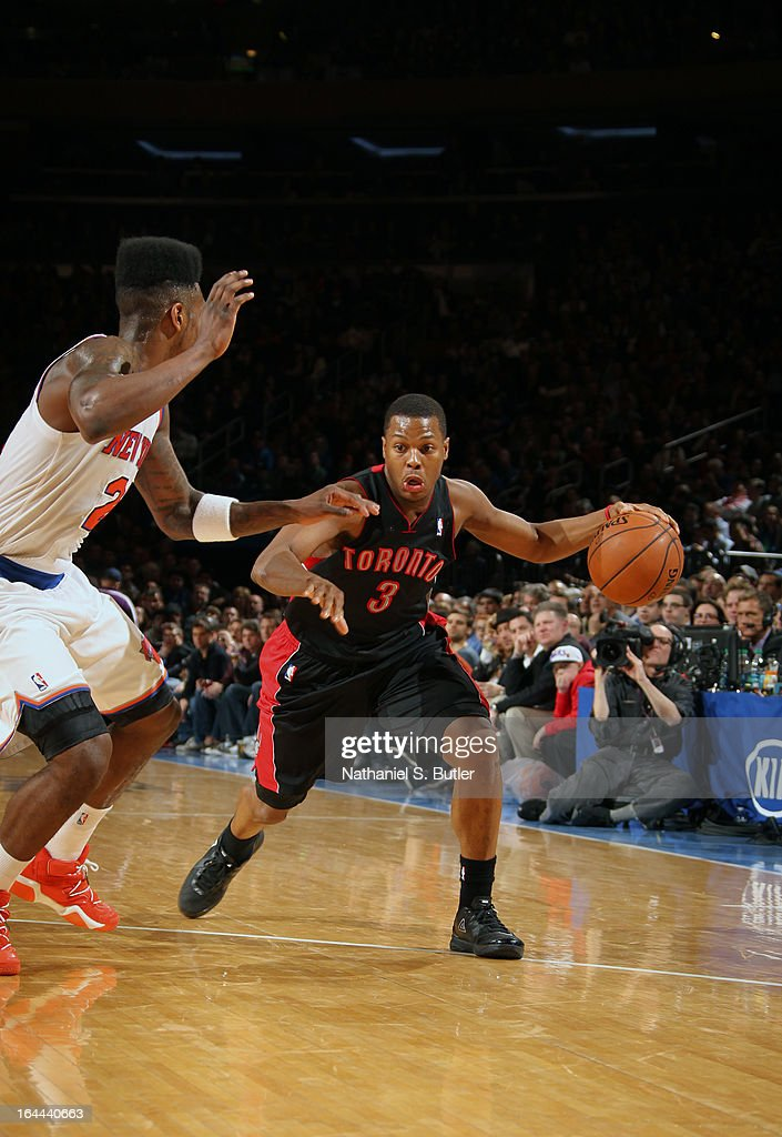 Kyle Lowry #3 of the Toronto Raptors drives against Iman Shumpert #21 of the New York Knicks on March 23, 2013 at Madison Square Garden in New York City.